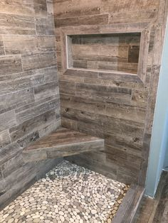 New house Plank tile shower walls. Jones Tile & Stone West Bend W Rustic Bathroom Shower, Master Bathroom Shower, Rustic Bathroom Designs, Bathroom Interior Design, Shower Walls, Stone Bathroom, Bathroom Ideas, Pebble Shower Floor, River Rock Shower