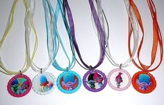 Bottle Cap Necklaces are metallic colored bottle caps with colorful images printed on high quality glossy photo paper. Bottle Cap Necklaces on assorted colored ribbon necklaces. Images are sealed with premium 3-D epoxy domes for super clear, high gloss pictures. | eBay!