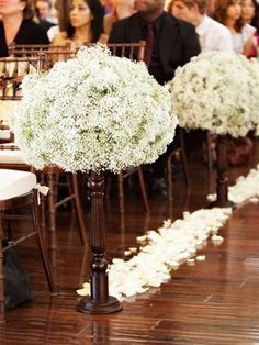 Baby's Breath w a few red flowers and roses....acutally looks very nice and will  be soooo  much less expensive then we can afford to do something nice like this on the pews