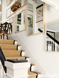 Staircase with runner and mirrored gallery wall -add mirrors on the wall to make it look bigger