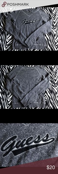 Grey Lightweight Guess Sweater Worn just a few times this Guess sweater is in excellent condition. It's a soft material that looks picky but hardly is! It's nicely fitted and look great with just about anything. Guess Sweaters V-Necks