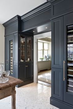 Dark gray cabinetry. Marble herringbone flooring. Kitchen. Details. Interior design.
