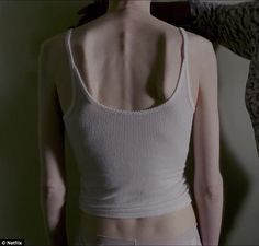 To The Bone tells the story of a 20-year-old woman suffering from a severe eating disorder. A trailer shows her performing a string of harmful behaviors such as calorie counting and obsessive exercise.