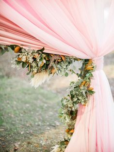 The Social Spool added a lot of pink to this fall reception. Then the florist added all the fall textures in garland form to line the entrances!