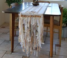 The Ornaments of Your House - Vintage Lace, Trinkets, and Burlap Rustic Country Farmhouse Table Runner OOAK FunkyJunkyArt. $112.00, via Etsy.