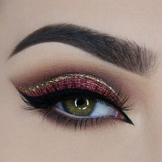 "Red glitter + gold glitter liner. Recreate this look with NYX Cosmetics 'Face & Body Glitter' in ""Red"" and 'Liquid Crystal Liner' in ""Crystal Gold""."