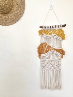 This combo of macrame and weave wall hanging is was hand-made by Hanifah Tohir in Sydney, Australia. Perfect to hang on its on own on a small wall or amongst other artworks in a cluster on a larger wall.   Measurement: Width: 50cm (stick end-to-end) Length: 60cm