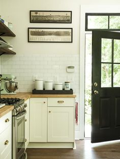 White cupboards, butcher block counter top, subway tile- I like everything about this kitchen, Erin!