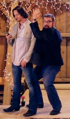 Tim is just checking his phone while Rob is goofing off! XD
