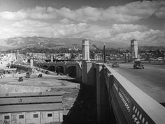 This view of Atwater and Glendale during the 1938 Los Angeles River flooding captures the Glendale/Hyperion bridge as well as the Forest Lawn Tower of Legends and mountain side sign.