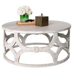 "Showcasing an openwork base and washed finish, this striking mahogany wood coffee table is the perfect canvas for a colorful reading lamp or stack of your favorite novels.   Product: Coffee tableConstruction Material: WoodColor: White washedFeatures:Openwork baseDimensions: 18"" H x 39"" Diameter"