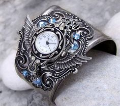 Beautiful steampunk watch by Aranwen. Love the wings and the Aquamarines.