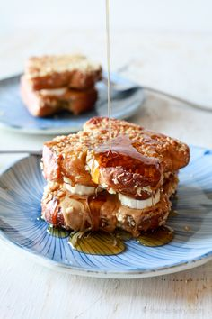 Almond crusted french toast filled with peanut butter, banana and honey. If you like sweet, crunchy and gooey you'll love this french toast.