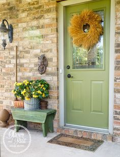 Bench at front door...pretty green...Oliver and Rust: Wood Garage Doors……for cheap