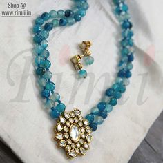 Blue necklace with kundan pendant . Available at Rimli Boutique Beaded Jewelry Designs, Jewelry Design Earrings, Gold Earrings Designs, Gold Jewellery Design, Necklace Designs, Agate Jewelry, Bead Jewellery, Indian Jewelry Sets, Gold Jewelry Simple
