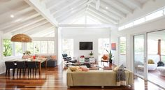 Love the floorboards, furniture colours, and pendant light. Beautiful exposed rafters. Houzz