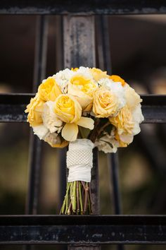 Lovely yellow bouquet. Photo by Kevin Paul Photography. www.wedsociety.com #wedding #bouquet