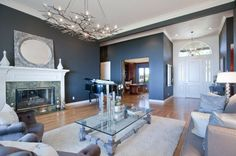 Living Room with stone fireplace, Crown molding, Shades of light circle in a square stamped metal mirror, Palladian window Living Room Colors, Living Room Modern, Living Room Designs, Living Rooms, Blue Rooms, Blue Walls, Palladian Window, Cool Chandeliers, Circle Light