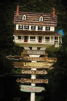 Bird house and signs
