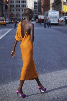Orange backless dress with purple shoes