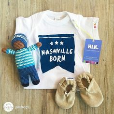 Pebble spotted! -repost from @jollifrogs Can't forget our Nashville Born baby boys!! Locally made onesie hand-knit rattle handmade (and vegan!) linen baby booties.#instarepost20 #PebbleChild