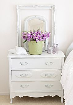 An all white room with pink flowers... so pretty!  #dresser