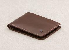 Or similar slim wallet (this one has no coin compartment)