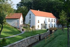 An old water mill converted into a charming apartment-hotel in the foothills of the Alps awaits you with crystal clear air, a gurgling brook and lot of heart-warming programs. City People, Community Space, Water Mill, Romantic Places, Malm, Hungary, Budapest, Palace, Mansions