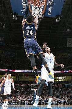 Paul George goes up for the dunk against the Oklahoma City Thunder on December 8, 2013.