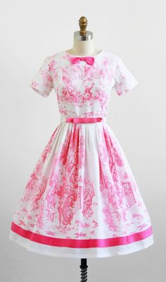 I love beyond love this gorgeous 1950s pink and white toile day dress with bow belt.
