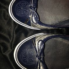 Tory Burch size 8 silver, navy and white sneakers These slip ons are fantastic! They go with so many things for spring and summer! Can be casual/cool or a dressier comfort go to! Tory Burch authentic size 8 silver/ navy. One imperfection.letter U off on one. Could write it I guess.....😉 Tory Burch Shoes Sneakers