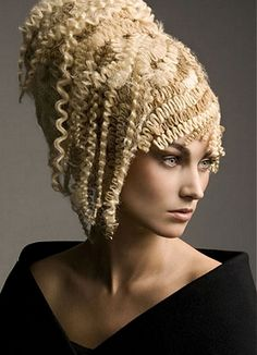 A long blonde wavy crimped coloured quirky avant garde hairstyle by Steven Carey