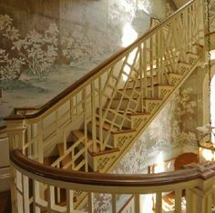 chinese chippendale fretwork stair railing with chinoiserie wallpaper