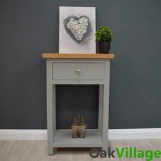 Greymore Telephone Table / Hall Table / Small Console Table Solid Oak & Hardwood Construction Professionally Finished In Our UK Spray Facility Dove Grey Colour FREE UK DELIVERY * 1 x Storage Drawer Lower Storage Shelf Maintenance Free Lacquer Finish Supplied Fully Assembled Unit Size: W50cm x H76cm x D39cm  The stunning Greymore range is sure to add sophistication to any home with its clean contemporary lines that will grace any living space it is placed in, with its clever use of country… Storage Drawers, Storage Shelves, Hallway Seating, Small Console Tables, Telephone Table, Grey Paint, Quality Furniture, Solid Oak, Living Spaces