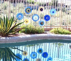 I LOVE Robin's garden suncatchers!  I own 4 of them now....they bring such pretty color to my garden and are made extremely well.  LOVE them!  Garden Art Cobalt Blue Glass Plate Flower Yard Stake by jarmfarm
