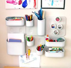 Great wall storage/organizer for kids art supplies. Urbio is super modern and clean, the art supplies become fun pops of color. -The Art Pantry