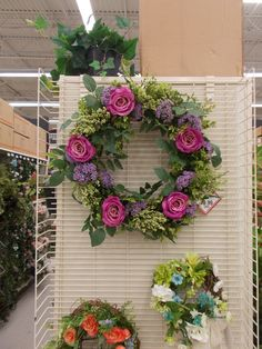 I love these purple roses so i used them on this wreath Sherrie