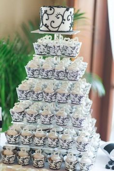 Pretty black and white wedding cake and cupcakes.