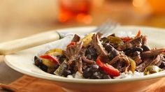 Slow-Cooker Cuban Flank Steak - Add something tasty to your family's Cuban dinner! Enjoy this slow-cooked steak recipe made with Progresso® black beans and rice. Best Slow Cooker, Crock Pot Slow Cooker, Crock Pot Cooking, Slow Cooker Recipes, Cooking Recipes, Cuban Recipes, Crockpot Recipes, Crockpot Dishes, Slow Cooked Steak