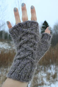 I have published an updated version of this pattern! If you downloaded your pattern before March 28, 2012, please re-download an updated version! The new pattern corrected errors in stitch counts for the thumb increases, and a clarification about the yarn requirement. Thanks to all who helped me with this pattern, especially birgit1501!