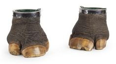PAIR OF SILVER MOUNTED RHINOCEROS FOOT WINE COOLERS -  EARLY 20th Century - (NOTE: BEFORE THE BAN ON POACHING) -  Each specimen with an unmarked silver mounted collar with a scalloped edge, and fitted with a removable green painted zinc liner (2)   20cm high