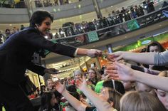 Girl Scouts of the USA CEO, Anna Maria Chávez, handing out her patch at the Mall of America Great Girl Gathering.
