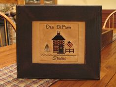 """Dan DiPaolo Studios"" designed and stitched by Yesterday Once More Primitives."