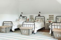 14. Create a grown-up bunk room. In order to sleep a crowd, Holly outfitted a sophisticated bunk room with iron twin frames, wired baskets that stand in for luggage racks, and made-in-Austin sconces that allow her guests to read without disturbing their roommates.