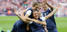 YAY!!US players celebrate with Carli Lloyd after the first of her two goals vs. Japan.