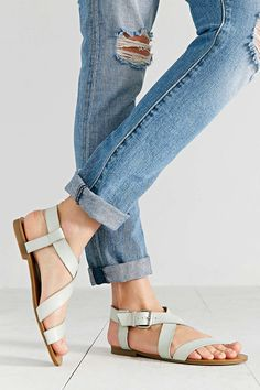 Strappy flat sandals in a pretty sky-blue shade.