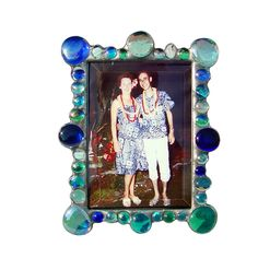 "Diane Markin creates this artistic, Blue New Jewel Photo Frame. A wide border of medium and small jewels, scattered like an explosion of bubbles. * Sizes and Prices Available: A. 3.5"" x 5"" $55.00 B. 4"