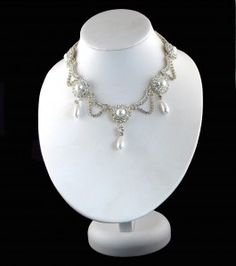 The necklace was given to Princess Alexandra by the Prince of Wales as a wedding gift in 1863.  She wore it on her wedding day.  The necklace has eight circular clusters of diamonds with a large pearl in the centre of each connected by festoons of diamonds.  The necklace has belonged to Queen Elizabeth, the Queen Mother since the accession of King George VI in 1936'