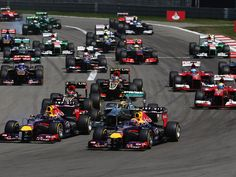 Both Red Bulls swamp Hamilton on the run to turn one at the start of the German Grand Prix