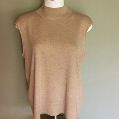 Cold water Creek sparkly gold sleeveless shell Cold water Creek sleeveless mock turtleneck. Gold sparkly holiday and evening wear top. Size XL. Great condition. Armpit to armpit 20 inches. Fabric is stretchy. Shoulder seam near neck to bottom is 23 1/2 inches. See close up picture for best color and sparkles.  Coldwater Creek Tops